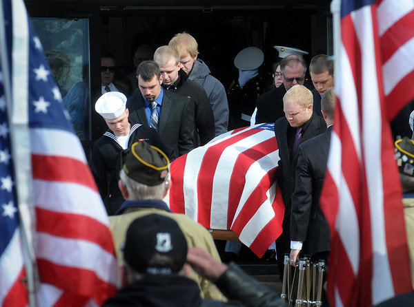 Pall bearers carry the casket of fallen Marine Caleb Erickson from Grace Lutheran Church in Waseca following his funeral service.