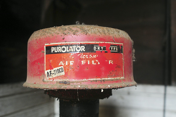 This air filter sits atop a pipe in Ed Enos' garage. The pipe is connected to a hand pump in Enos' fallout shelter and would have been used to draw in fresh air. — Tiffany Wolfe