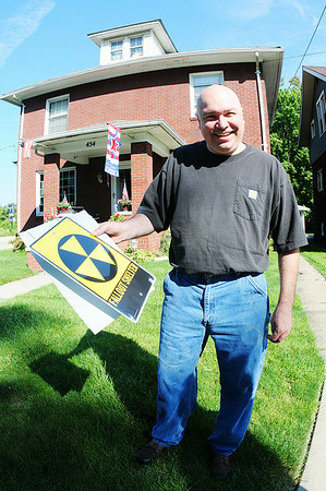 Ed Enos has plans to restore his fallout shelter. He's started by buying a sign for it. — Tiffany Wolfe