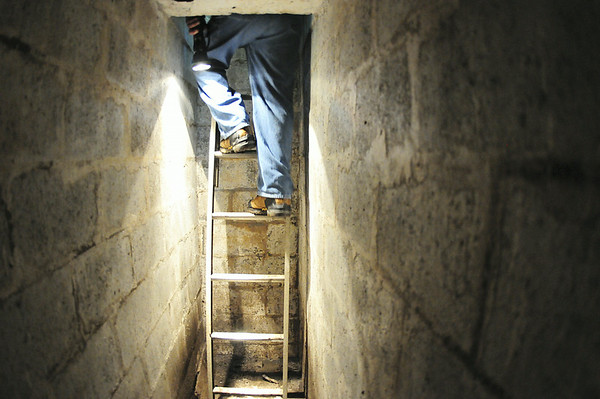 Ed Enos climbs the ladder to leave his fallout shelter. — Tiffany Wolfe
