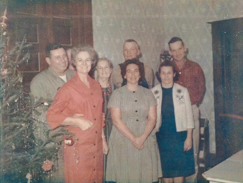 Christmas at Marshall & Jean Ellis' house.  Clarence Roberts (Aver's husband), Aver, Bess, Jean Ellis, Georgia Ellis, Fred Moore (Bess' husband), Marshall Ellis, James Ellis