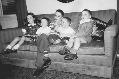 "Caption:  ""New Year's Eve, 1951""  (l-r:  Cathy, Mary, Ralph, Bob, and John)"