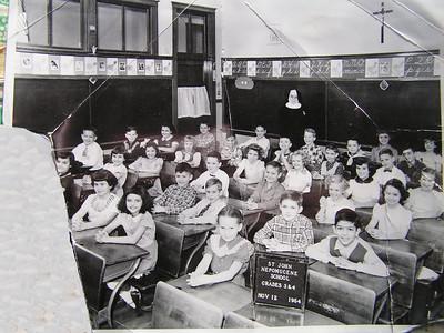 2 1 2014 4th grade, St John Nepomecene, nov 1954. Tommy, last row, just to Sister's right.