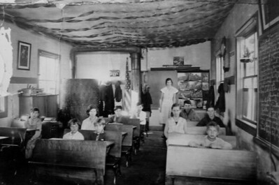 1 8 2014 Dad's 1-room school house, Lyndon Station, WI about 1937  Dad is in last seat on rt side