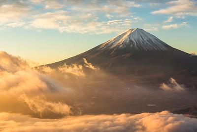 Fuji mountain and the mist over Lake Kawaguchiko at beautiful sunrise , Yamanashi, Japan, Mount Fuji or Fujisan located on Honshu Island, is the highest mountain in Japan.