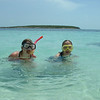 Twins snorkeling in the Bahamas.