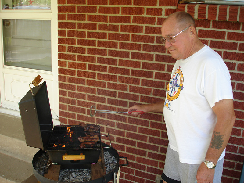 Pa doing some grilling.