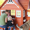 Samantha gets her first look at the new playhouse with Aunt Jo and Charlie