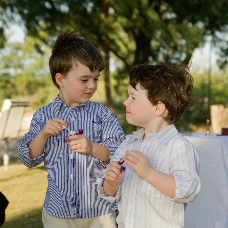 Alexander and Oliver blowing bubbles