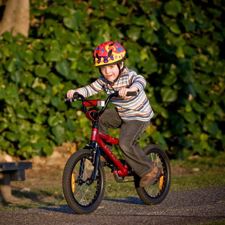 Alexander on his new bike (South Broadbeach esplanade, sunset)