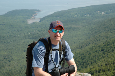 Brian taking a break while at Acadia National Park in June 2010.  The next time he heads out on a photoshoot he plans to acquire a local mule to lug the gear around.  Oh, I mention that I'm not a big fan of heights!