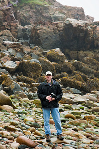 Brian at Rock Beach in Acadia National Park, Maine.  Let me tell you, those rocks were slick so guessing I was standing there worried about slipping and winging the camera across the rocks.  It was also raining most of that day so we were getting drenched.