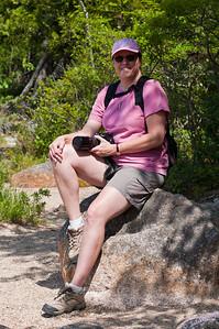 Linda taking a rest at Jordan's Pond in Acadia National Park, Maine