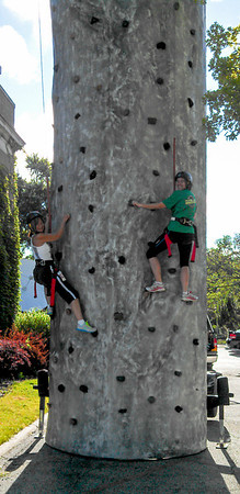 Bix 7 2013 - Linda's friends climbing the rock wall
