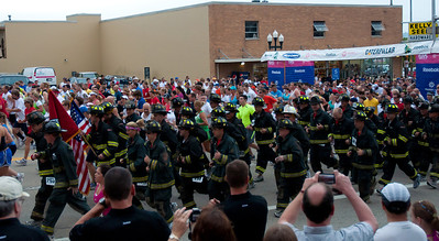 Steamboat Race Peoria Illinois 6/18/2011 - Illinois' Toughest 15K - Have to give credit to the Firefighters who run the 4 mile race in complete gear in honor of their fallen during the events of 9/11