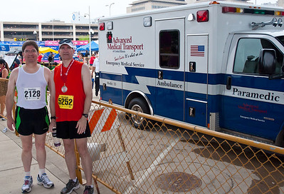 That's my good friend Ron Owdom on the left.  Ron took the 4 mile course (we actually ran together until the 4 mile course broke off for home) this year, but plans to be wearing the yellow bib next year.  It's becoming tradition now that we take our post race picture next to ambulances in tribute to another successful race.  Steamboat Race Peoria Illinois 6/18/2011 - Illinois' Toughest 15K