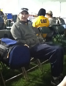 3.5 Corporate Chase Race May 26th, 2011 Chicago IL. 23K people - Brian trying to stay warm before the start of the night race - the feels like temperature was 36 and it had been raining for days straight.  After fighting through the crowd due to starting way behind my intended starting location I crossed at 27:30 which I was elated with given the conditions and the struggle to free up from the crowd. - Shot courtesy of Sung Pak