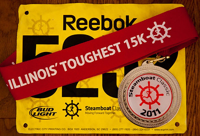 Steamboat Race Peoria Illinois 6/18/2011 - Illinois' Toughest 15K.  After a tough night before, I was elated to take a gun time of 1:19:27.  Still awaiting the official chip time and splits.  As a note to myself, the starting line weight was 154 which is the lightest I've lined up to date (some of that due to the night before)