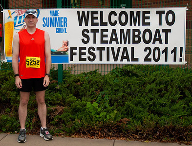 Steamboat Race Peoria Illinois 6/18/2011 - Illinois' Toughest 15K - This is actually the pre-race shot and the slightly concerned expression is a result of fighting a stomach bug all night and a little concerned about the dude in the picture staring at me