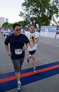 Brian (right) and his friend Sung - Corporate Chase Race in Chicago this year.  This was Sung's first road race ever and Brian helped pace him to make sure he made it (if something would have happened to him, his wife would have killed me!)