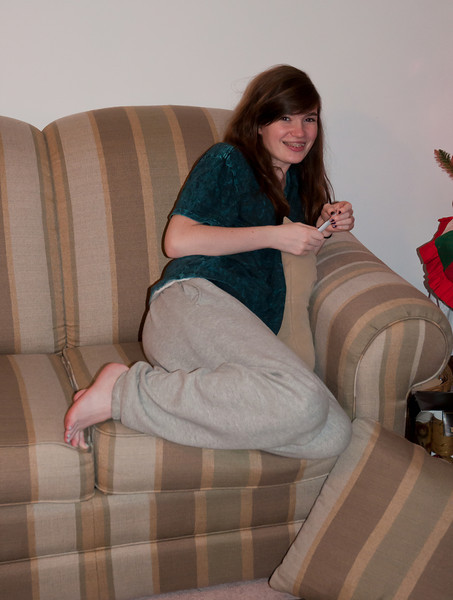 Lauren getting into a comfortable position to open presents