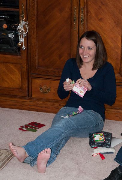 Kristen ripping open one of her gifts.