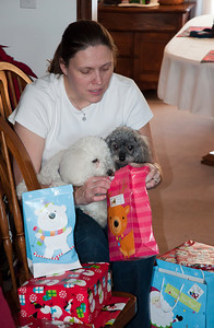 Linda helping Rizzi and Kerby open their presents.  Obviously this is not going fast enough for their liking.