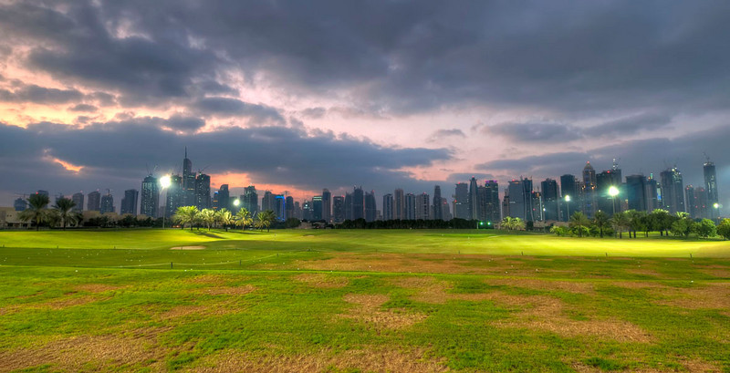 The Montgomerie driving range and Dubai Marina skyline.