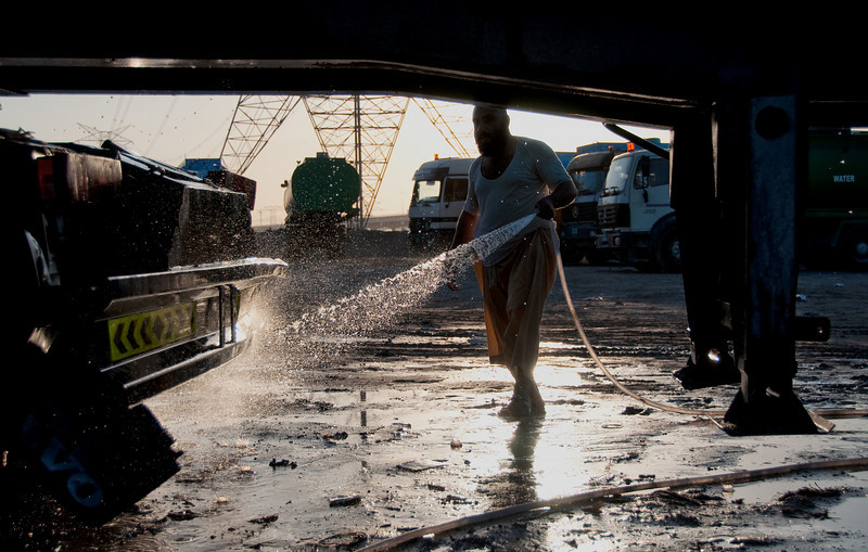 Water truck being washed. Jebel Ali, Dubai, United Arab Emirates.