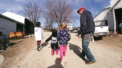 Girls visiting Jim at the farm
