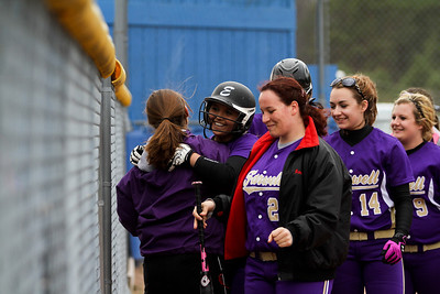 Ken Kadwell/@KenKadwell - Special to the Sun Farwell's Alisha Luster is greeted by teammates with celebration after Luster hit a home run that scored multiple runs against Harrison Thursday, April 24, 2014.