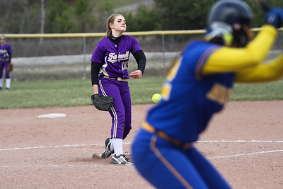 Ken Kadwell/@KenKadwell - Special to the Sun Farwell's Kate Saupe pitches against Harrison in the fourth inning at Harrison Thursday, April 24, 2014.