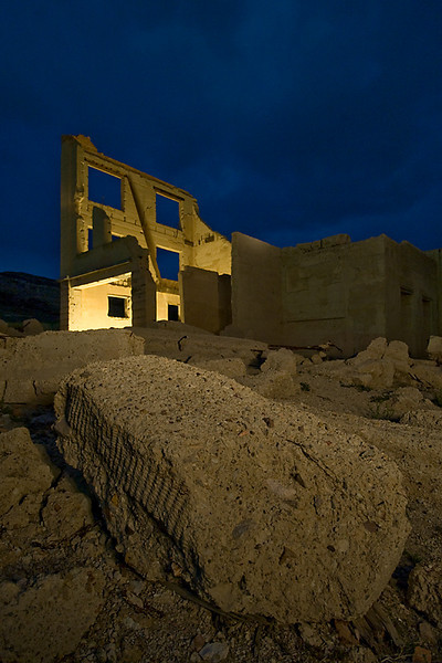 Financial Rubble<br /> <br /> Cook Building, Rhyolite, NV<br /> <br /> We placed a Coleman lantern inside the building and lit the foreground<br /> with a spotlight, feathering the edges of the beam.
