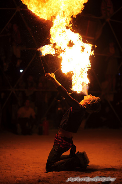 Fire artist Mark performing in the Thunderdome at Burning Man 2010.