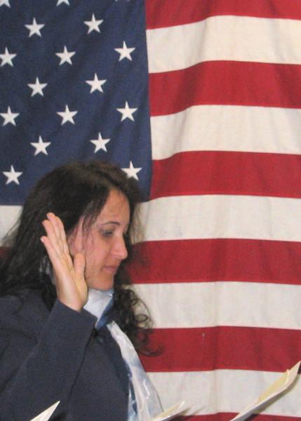 Cissa taking U.S. citizenship oath