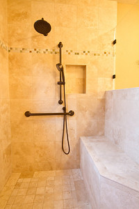 Built in bench and personal shower for universal access.