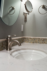 Lots of light and mirrors.  The two wall oval mirrors can tilt.  In addition, there is an articulated makeup mirror within reach.