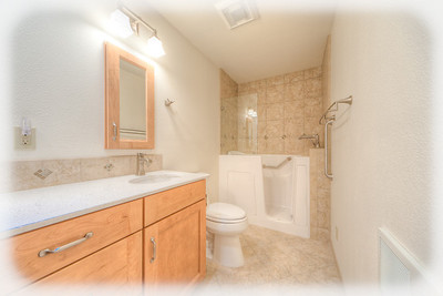 Nevada City walk-in bathtub remodel.  Note:  glass shield mounted on tub allows for seated shower.
