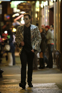 Brandon Hopkins and his creation - a blazer made of mirrors. Photo taken in Boston's North End on Hanover Street.