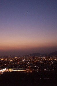 May 2002 Lima, Peru - This one of the Moon and Jupiter was taken around a half hour before the other picture of the same two subjects. For the first three years I lived there, I lived in the highest apartment building in Lima. That gave me the opportunity to take some great pictures of the city when the weather was good. The group of pretty sunsets in this gallery of Lima, Peru would lead you to believe that the weather there is nice. Let me make it clear, it is far from pleasant. I can't think of a place with weather more disgusting than this place. From December to about April are the summer months and the weather is warm and usually sunny. Then you have the REST of the year and its cloudy almost every single day. And I don't just mean cloudy - its gray, dingy, damp, misty, and cold. Its absolutely horrible. Only on occation during these winter months is there a nice day and while I was there, I managed to capture a couple of pictures of those nice days. For anyone that knows the city at all, the building I took these from was the Gremco Building located in Surco/La Molina (depends who you ask). Surco is in the forground.