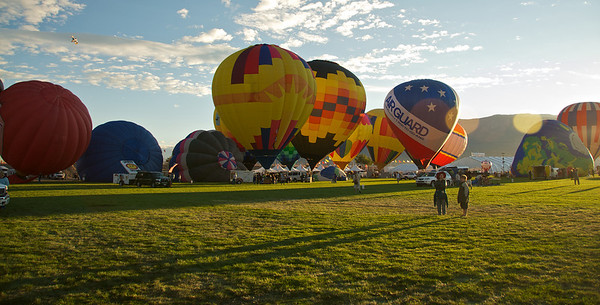 One of my favorites from the Albuquerque Balloon Fiesta. The long shadows and the two boys make a nice juxtaposition with the towering balloons behind them.