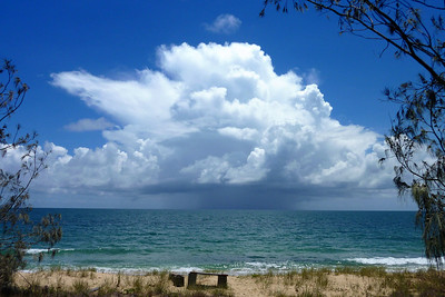 Summer storm over Fraser Island, taken about midday Christmas Day 2009 from Woodgate. No people on beach or in photo as too hot.