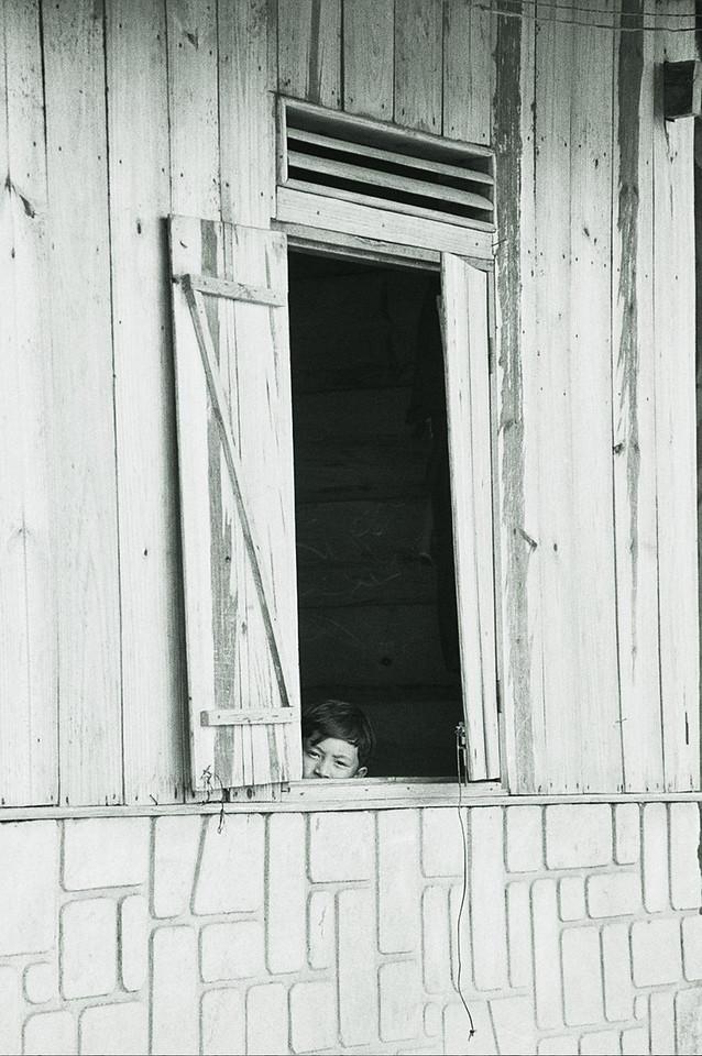 vietnam - young boy in window