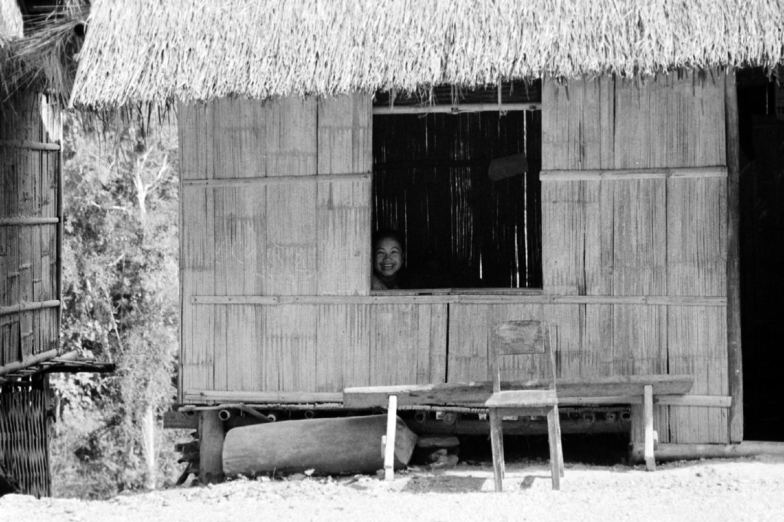 laos -smiley girl in window