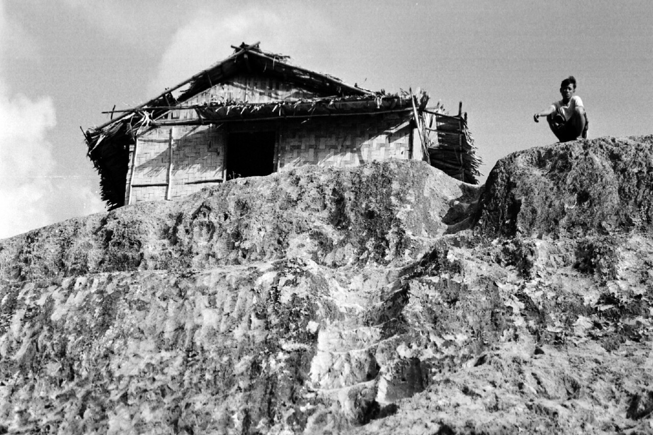 laos -man and house on hill