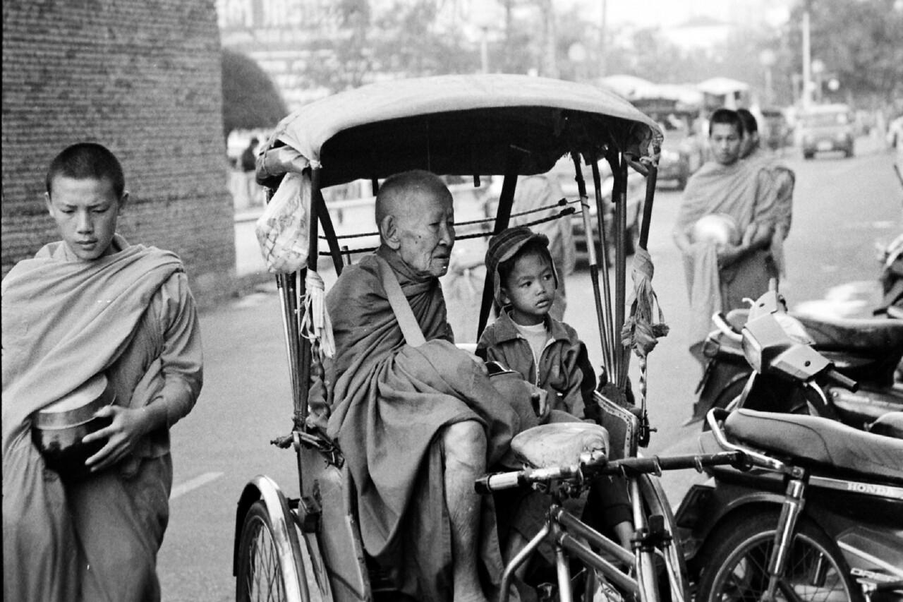 laos -monk with child on rickshaw 1