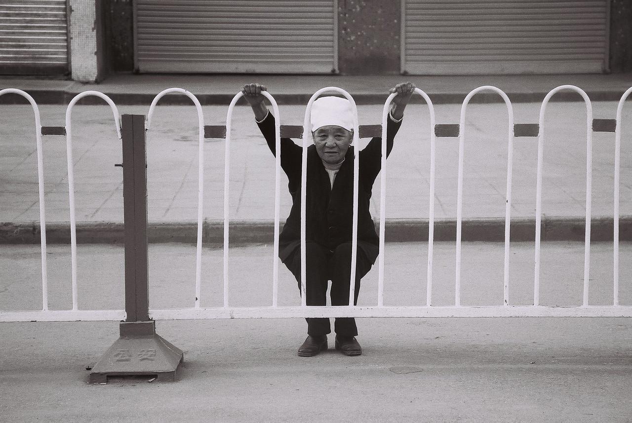 china -old lady on railings 1