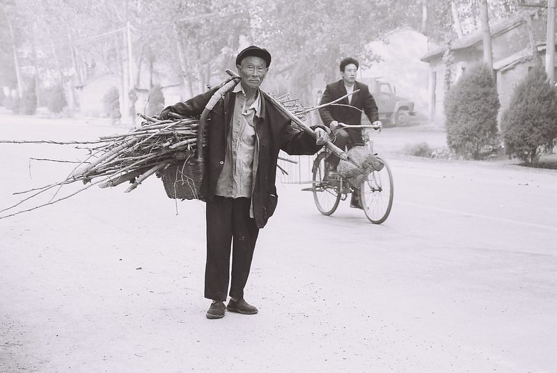 china -old man with firewood