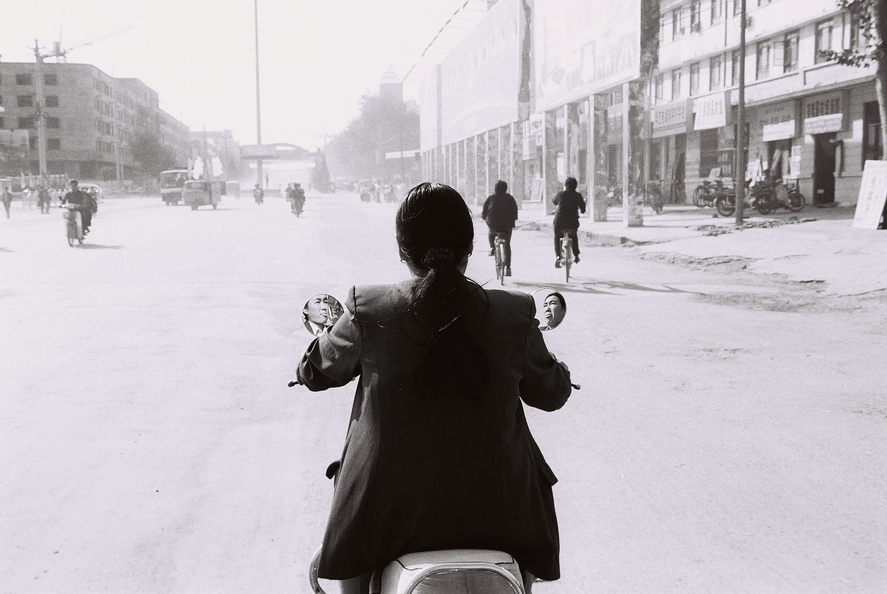 china -girl on moped