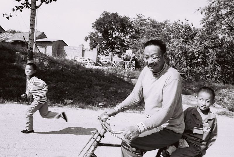 china -father and son on bike  1